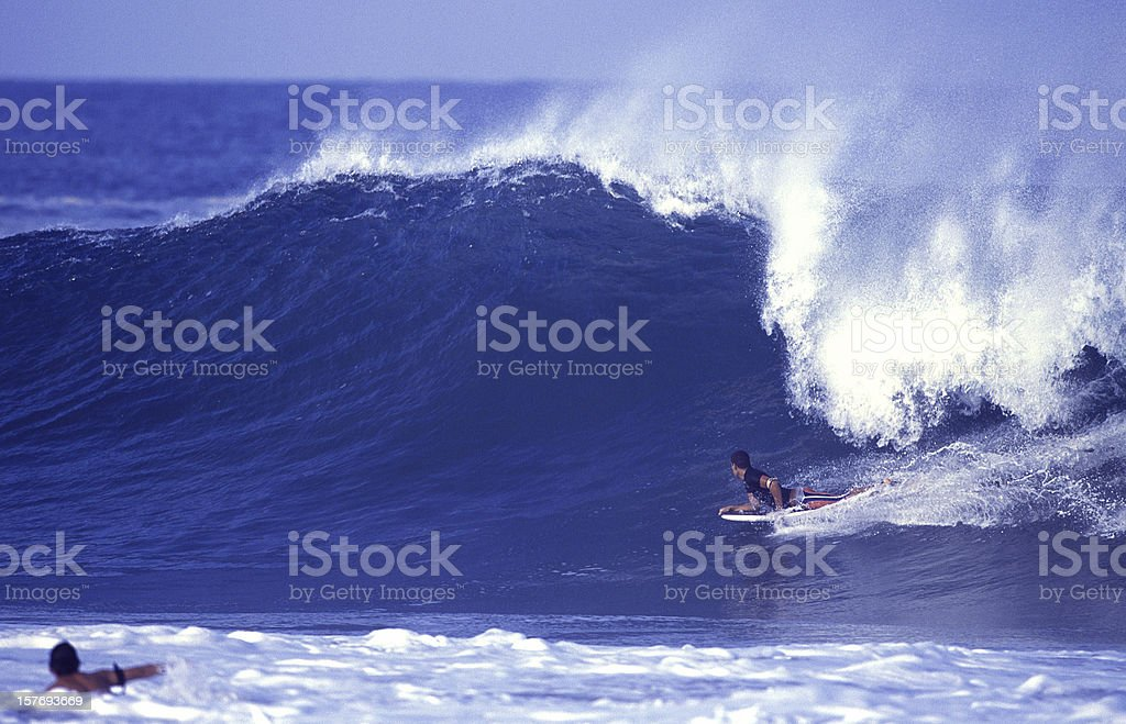 bodyboard rides a large tropical wave stock photo
