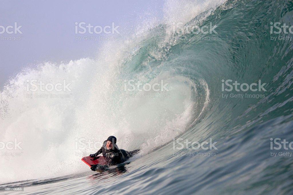 Bodyboarder on Powerful Wave stock photo