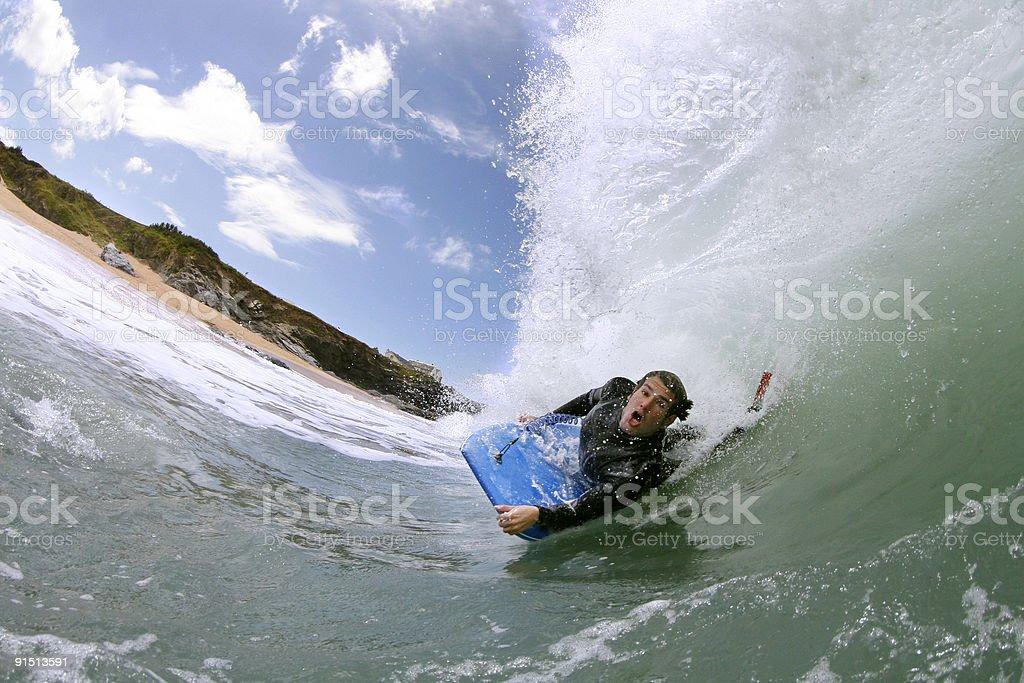 Bodyboarder Riding Powerful Wave stock photo