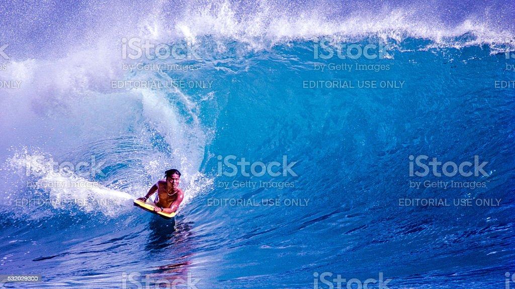 Bodyboarding at Sandy Beach stock photo