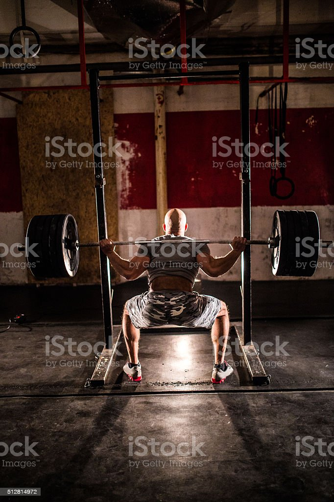 Bodybuilder at the gym,weight lifting stock photo