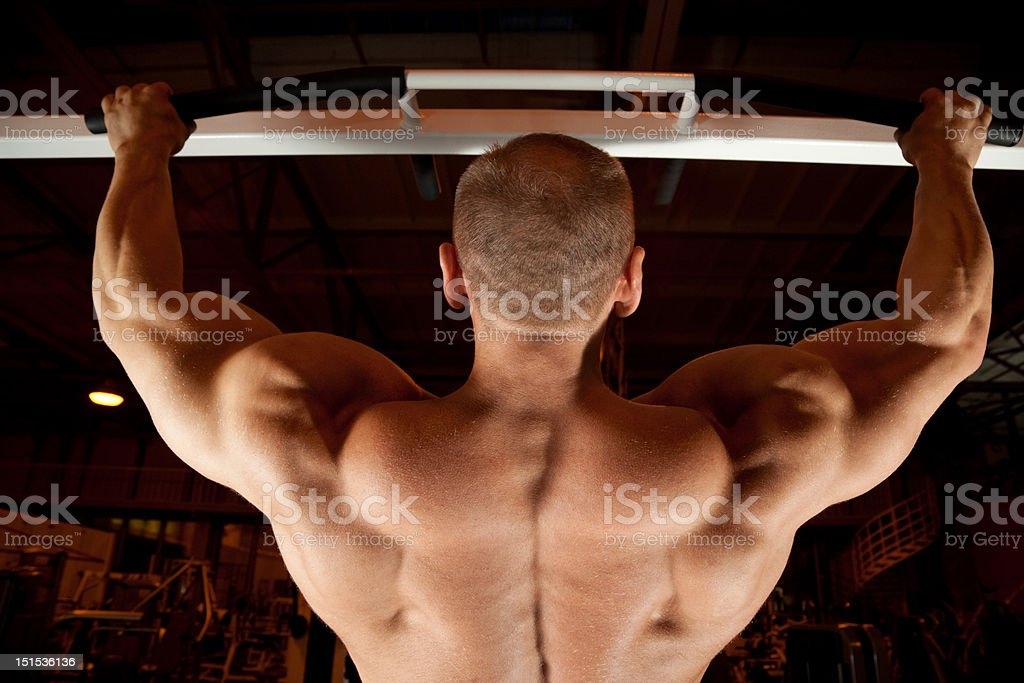 Bodybuilder back pull-up in training room royalty-free stock photo