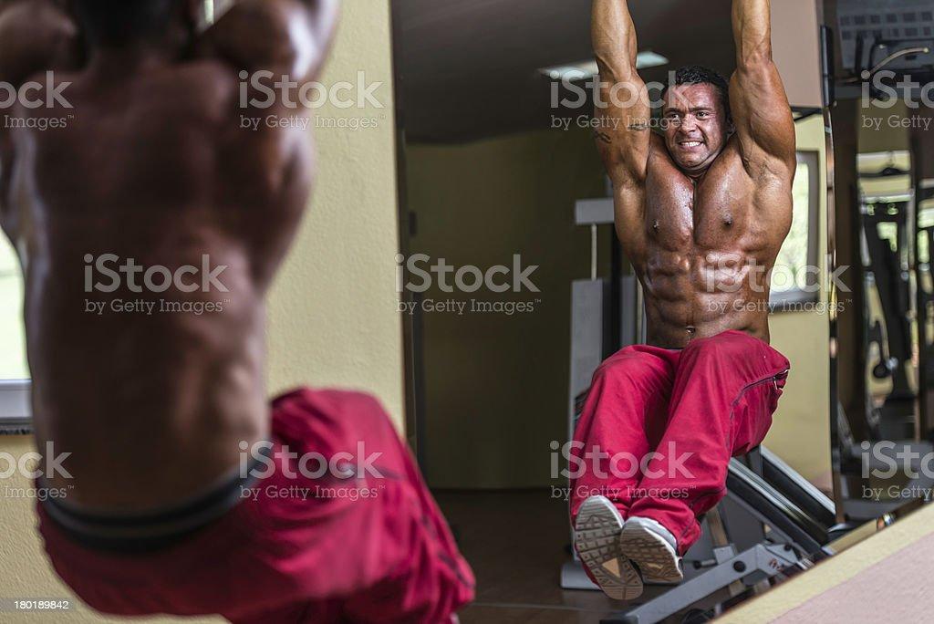 bodybuilder doing abs exercise royalty-free stock photo