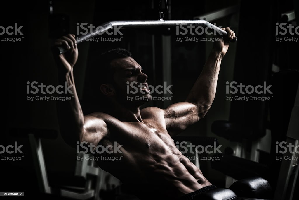 Bodybuilder Doing Heavy Weight Exercise For Back stock photo