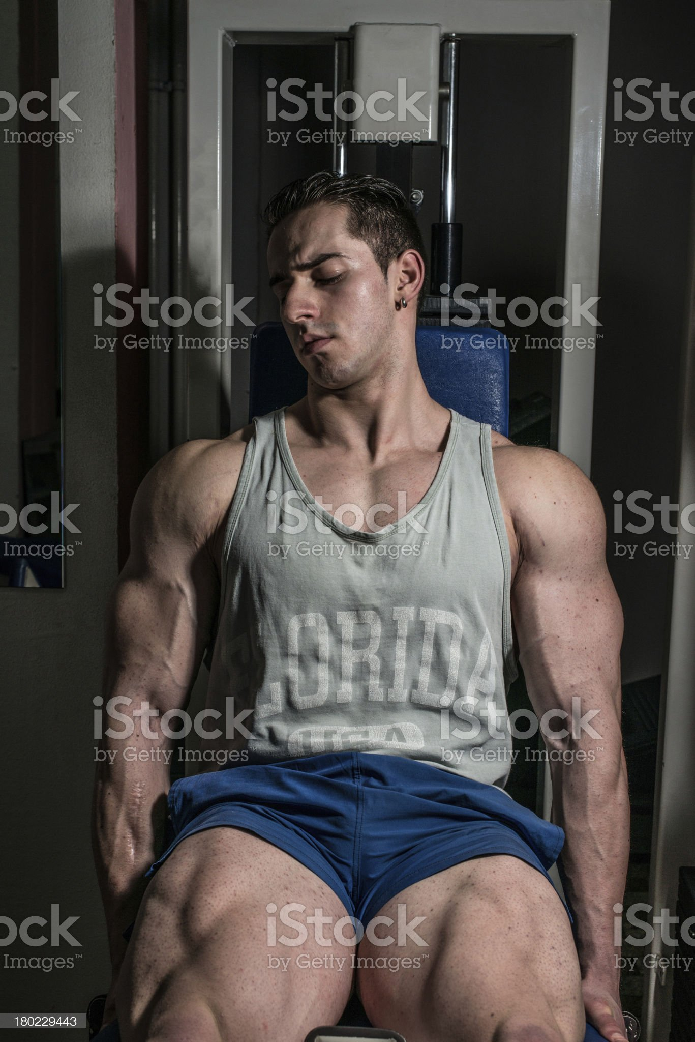 bodybuilder doing heavy weight exercise for legs royalty-free stock photo