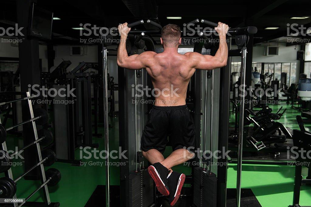 Bodybuilder Doing Pull Ups Best Back Exercises stock photo