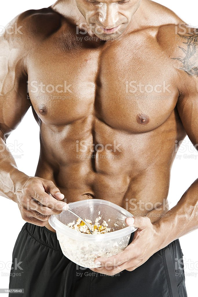 Bodybuilder eating royalty-free stock photo