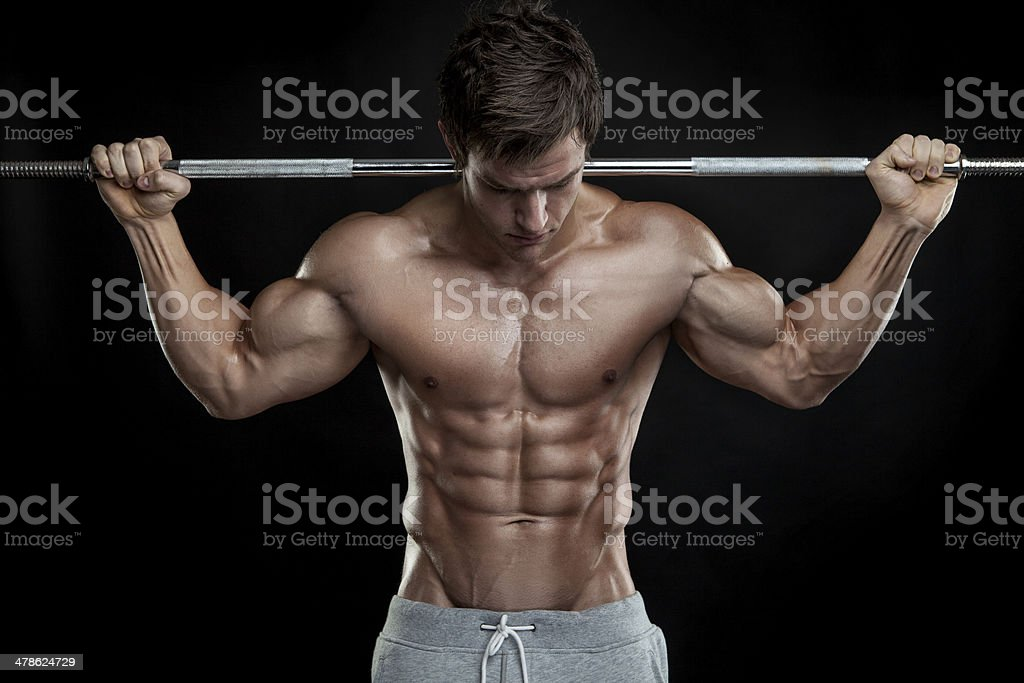 Bodybuilder exercising with dumbbells stock photo