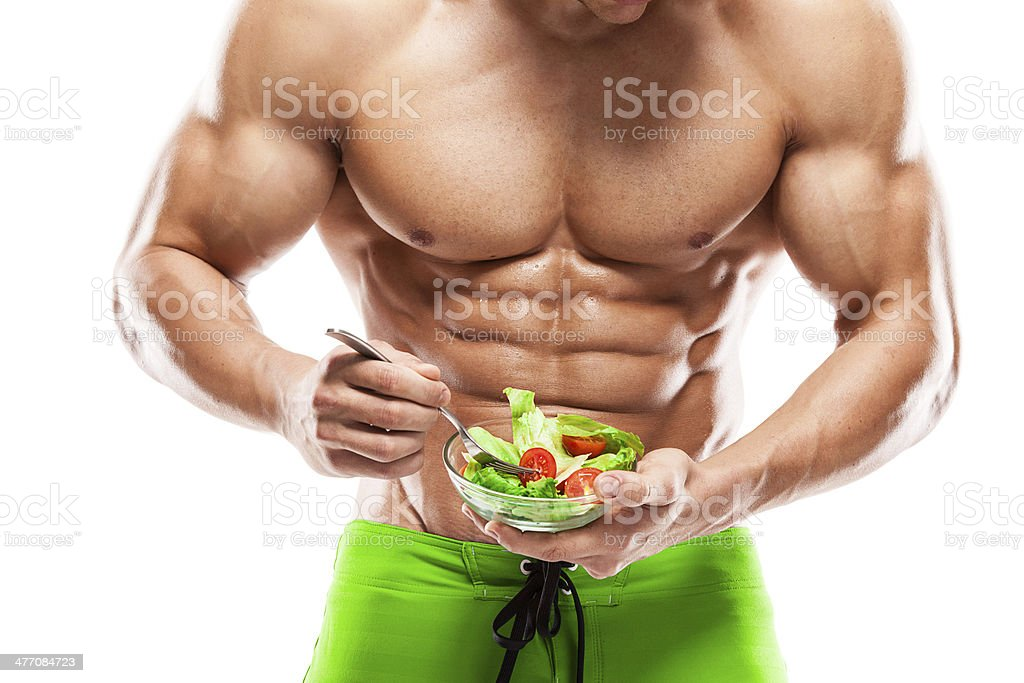 Bodybuilder holding a fresh salad bowl stock photo