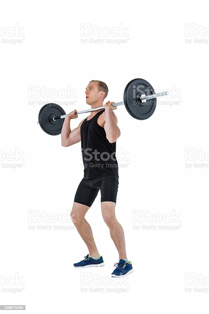 Bodybuilder lifting heavy barbell weights stock photo