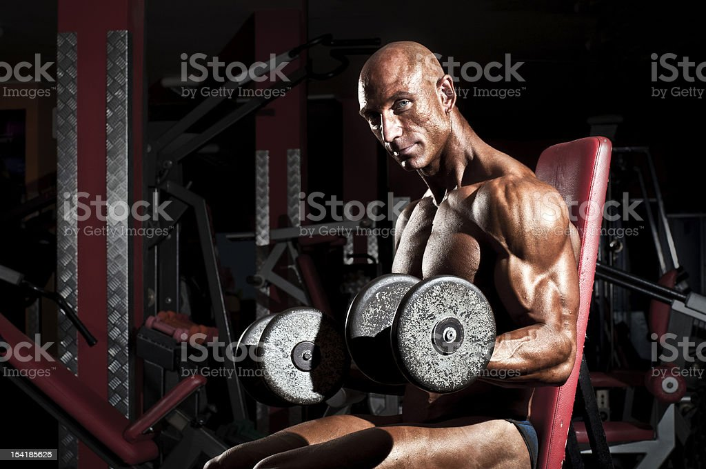 Bodybuilder lifting weights in the gym. royalty-free stock photo