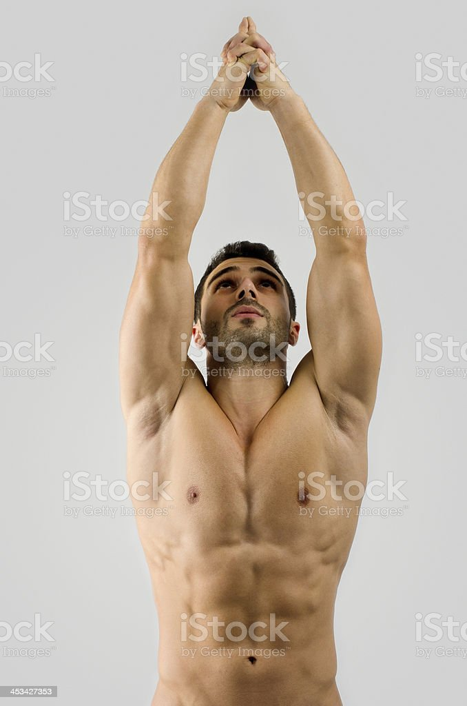 Bodybuilder man with perfect abs,biceps, triceps chest pointing up stock photo