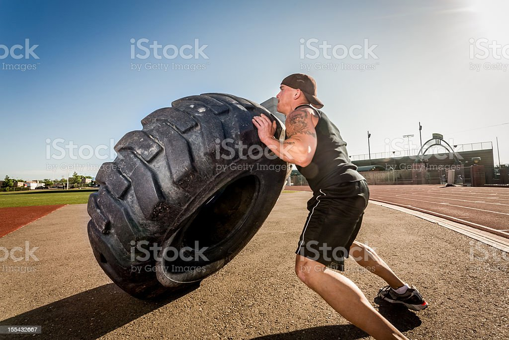 BodyBuilder Man with Truck Tire stock photo