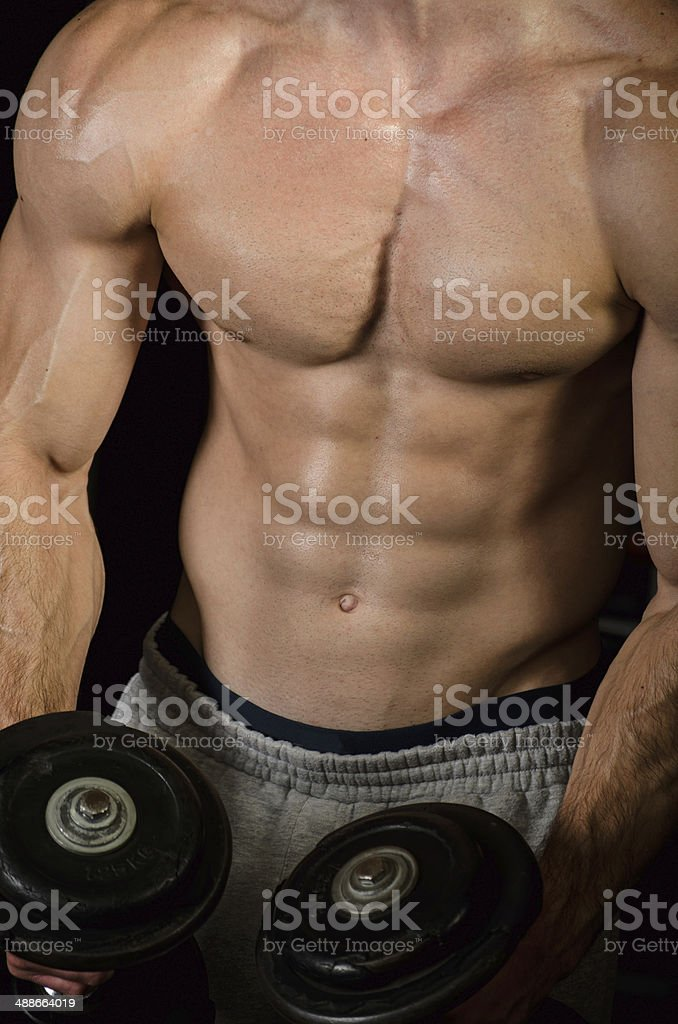 Bodybuilder Performing Bicep Curl with Dumbbell stock photo