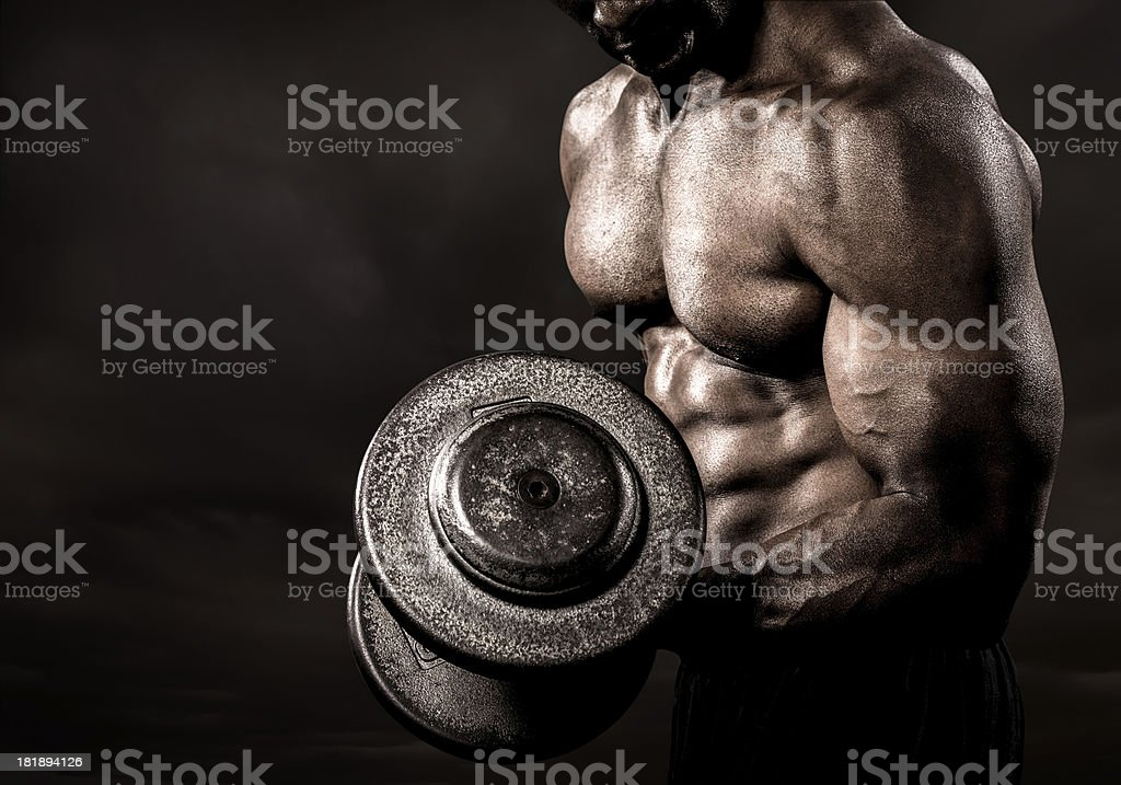 Bodybuilder performing power lift curl stock photo