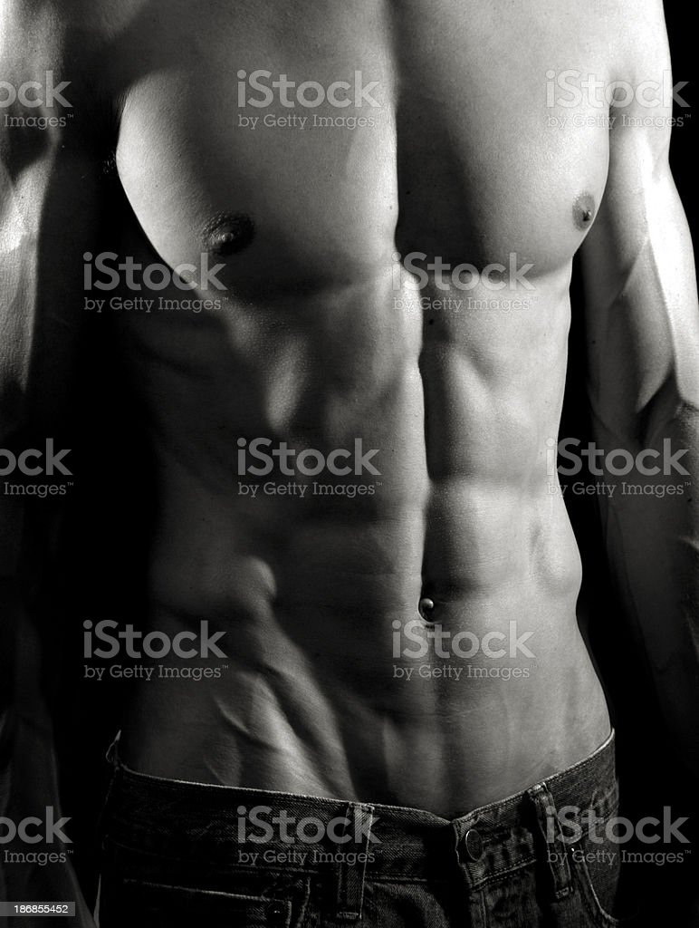 Bodybuilder posing on black background. royalty-free stock photo