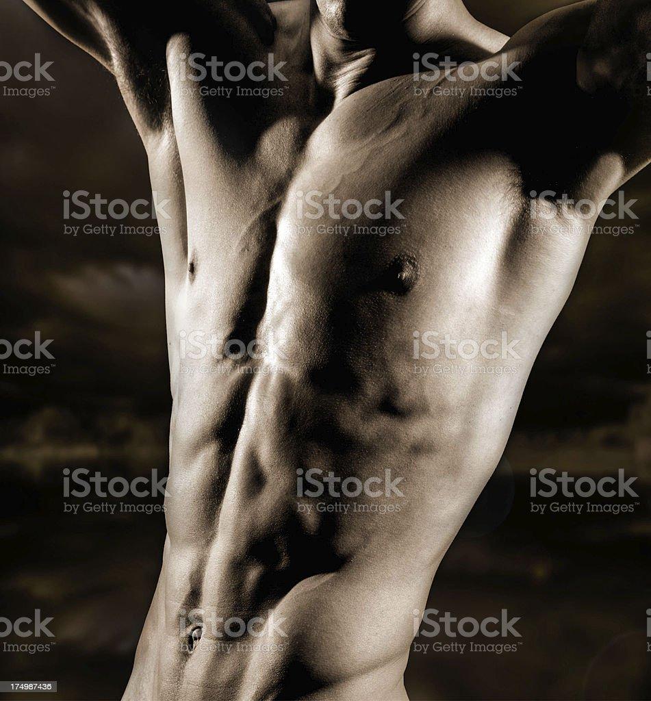Bodybuilder posing on mottled background. royalty-free stock photo