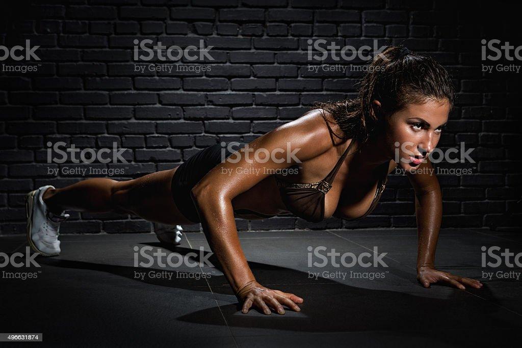 Bodybuilder pushing up stock photo