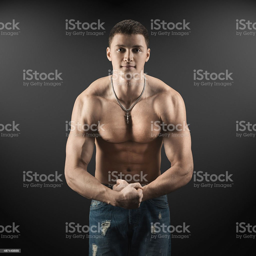 bodybuilder showing muscles in the arms stock photo