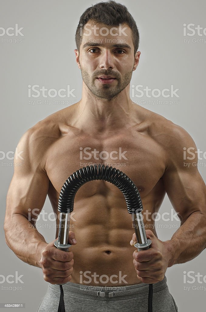 Bodybuilder training with a bendy bar royalty-free stock photo