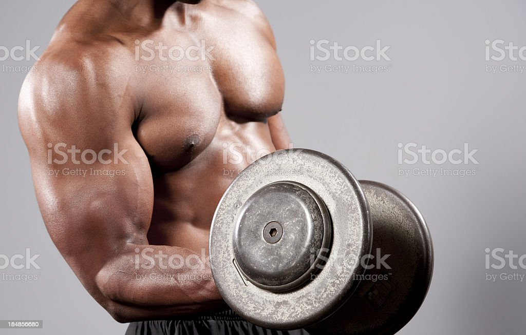 Bodybuilder using heavy barbell royalty-free stock photo