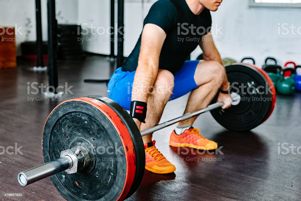 Bodybuilder weightlifting in the gym stock photo