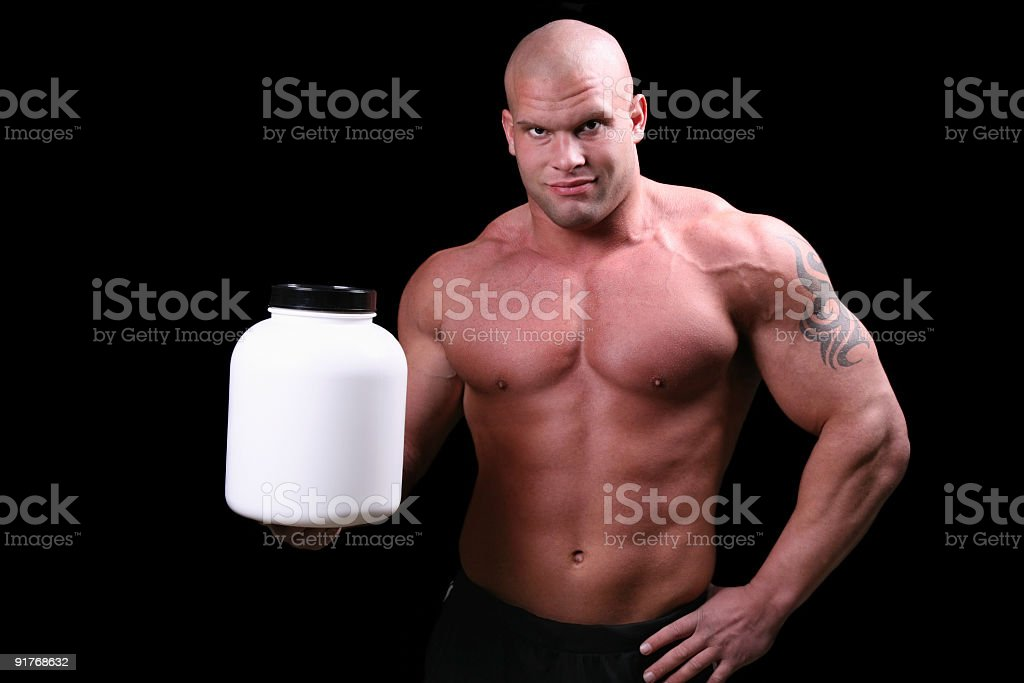 Bodybuilder with blank can royalty-free stock photo