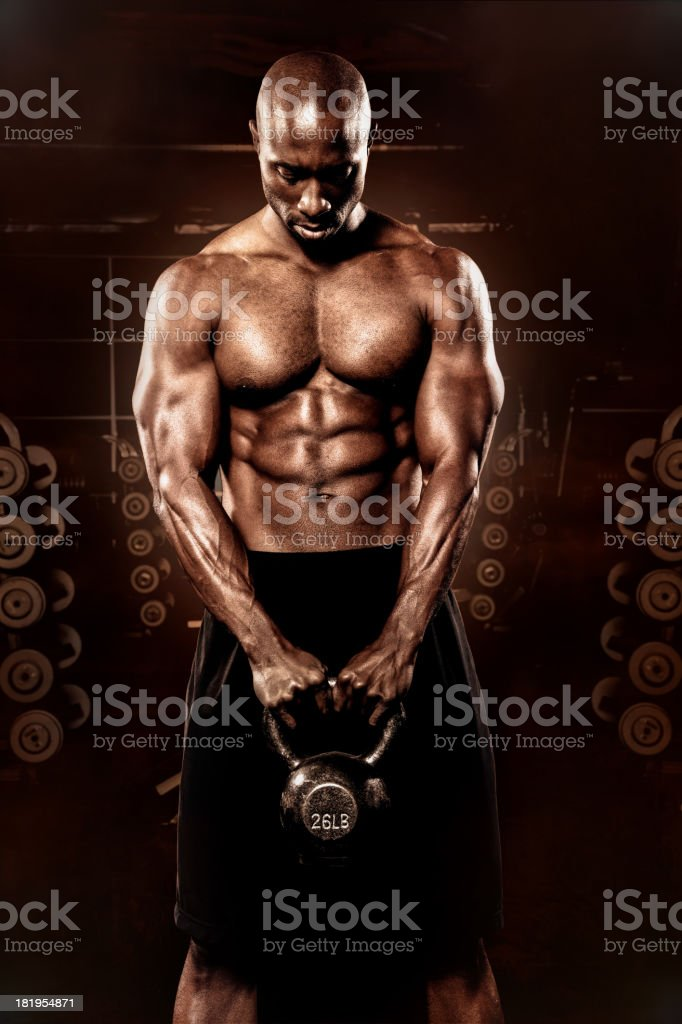 Bodybuilder with kettle bell, layered conceptual image royalty-free stock photo