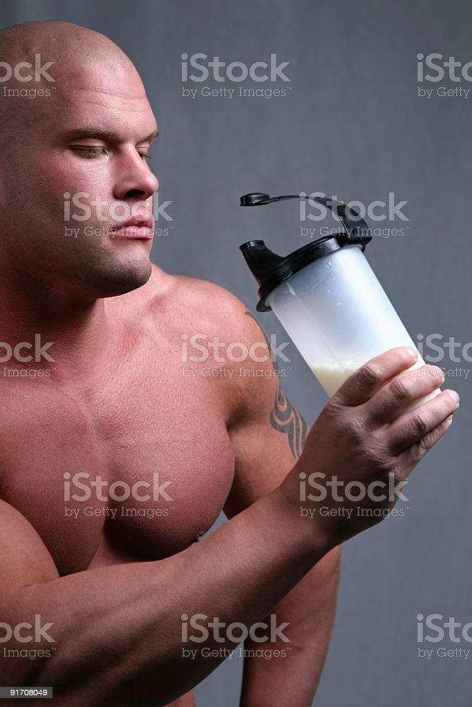 Bodybuilder with protein shake royalty-free stock photo