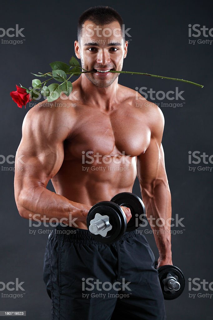 Bodybuilder with red rose royalty-free stock photo