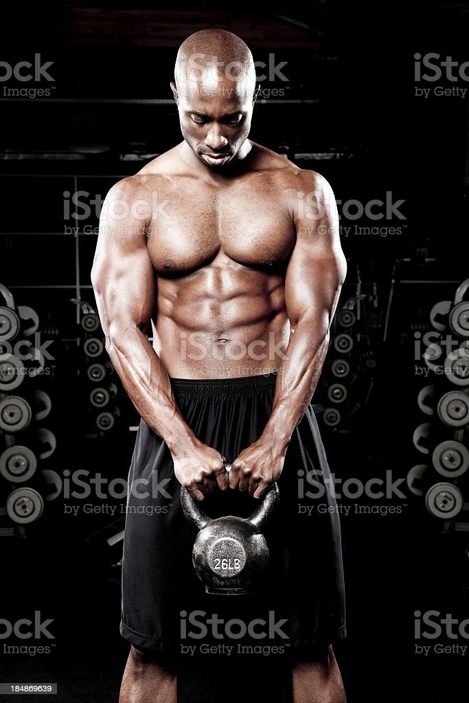 Bodybuilder working out in gym royalty-free stock photo