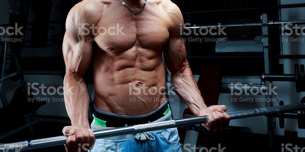 Bodybuilders top body lifting bar stock photo