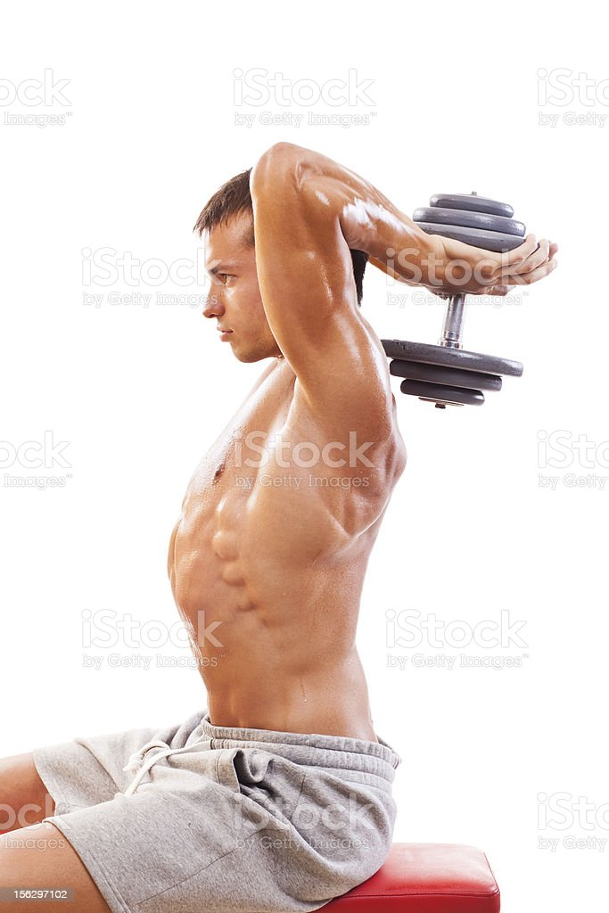 Bodybuilding exercise, two - arm triceps extension. royalty-free stock photo