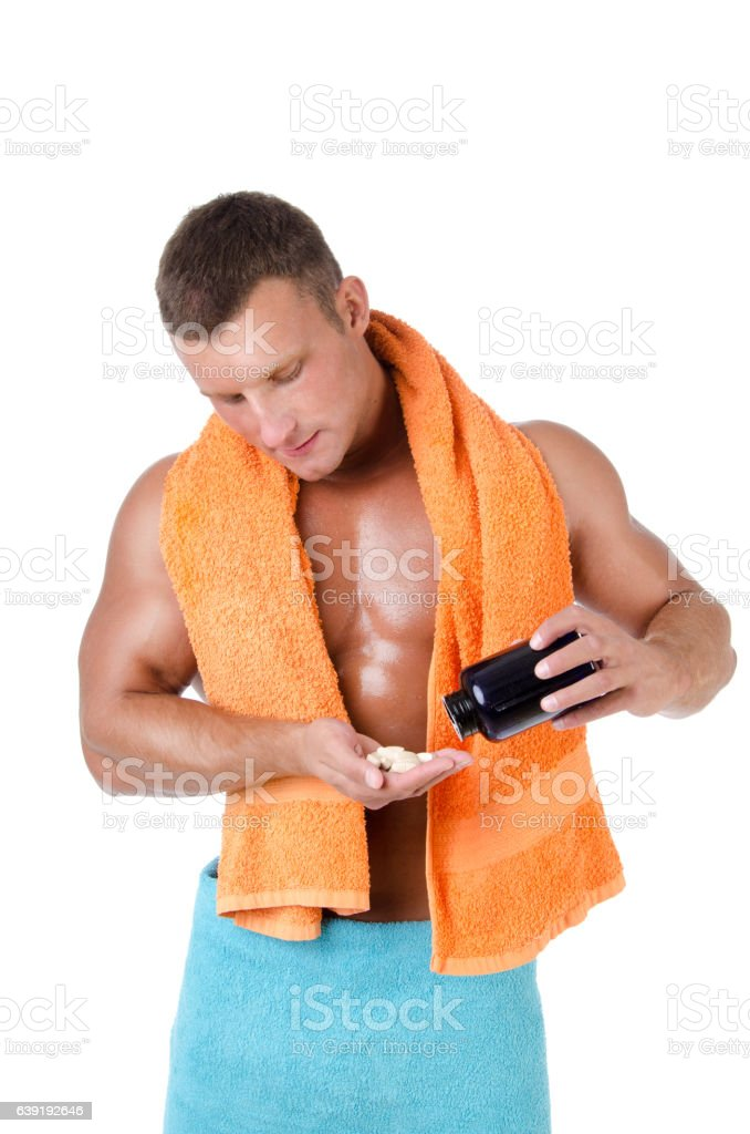 Bodybuilding Supplements and naked man. stock photo