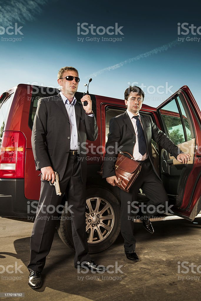 bodyguard and its boss royalty-free stock photo
