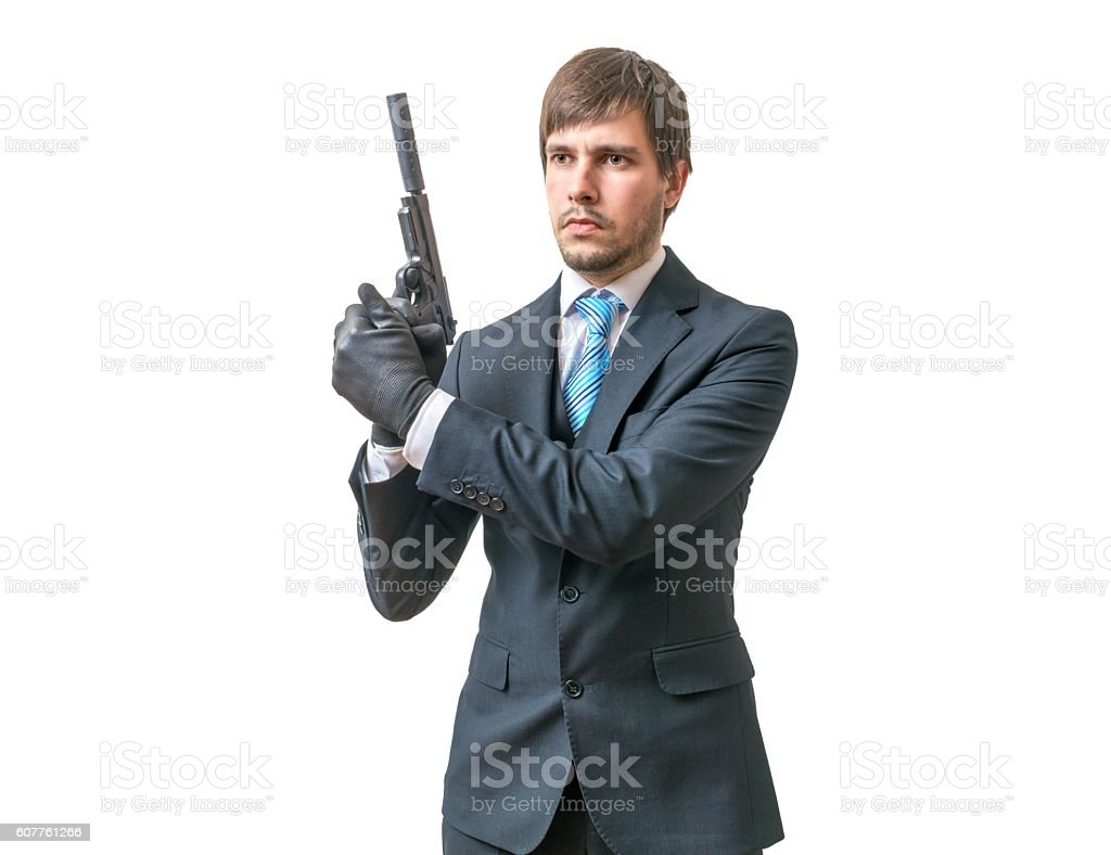 Bodyguard or agent with pistol in hands. Isolated on white. stock photo
