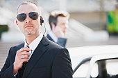 Bodyguard talking into earpiece