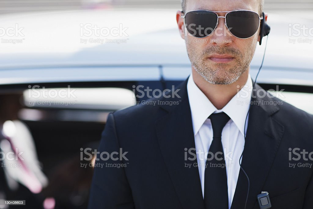 Bodyguard wearing earpiece stock photo