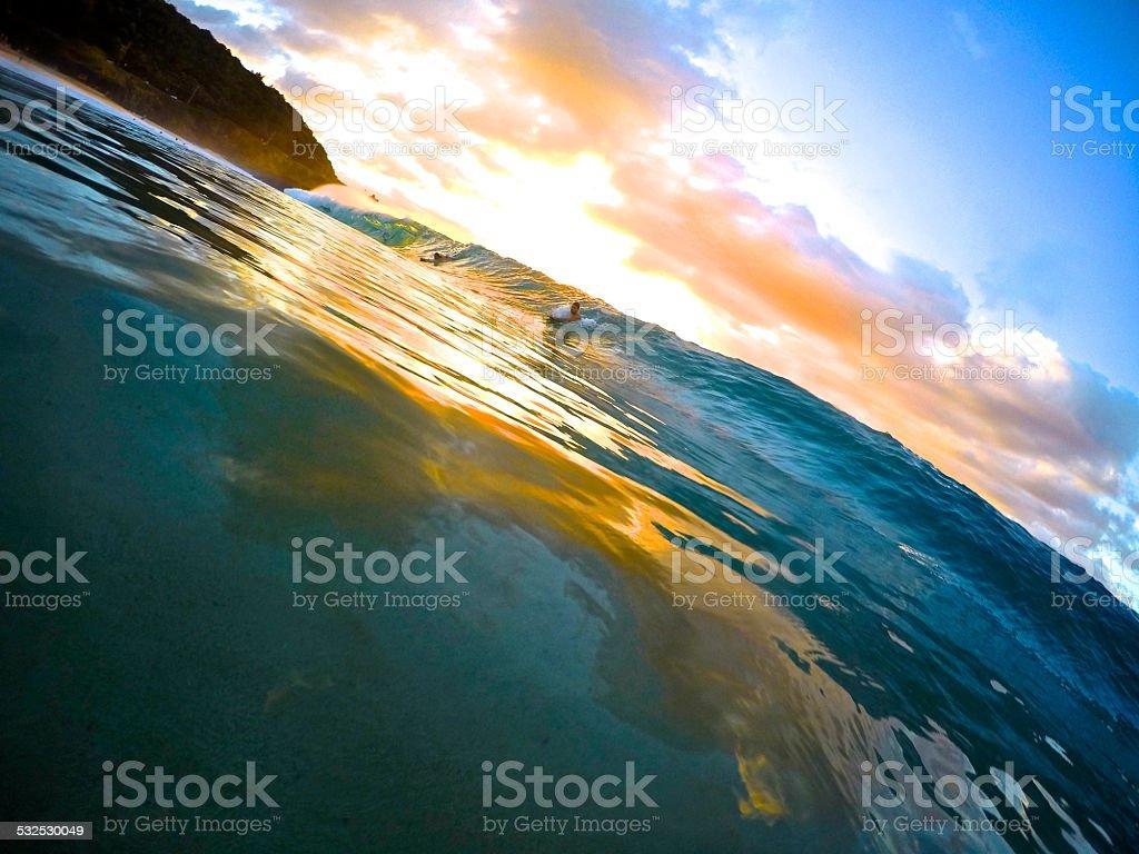 Bodysurfing Waimea Bay Hawaii stock photo