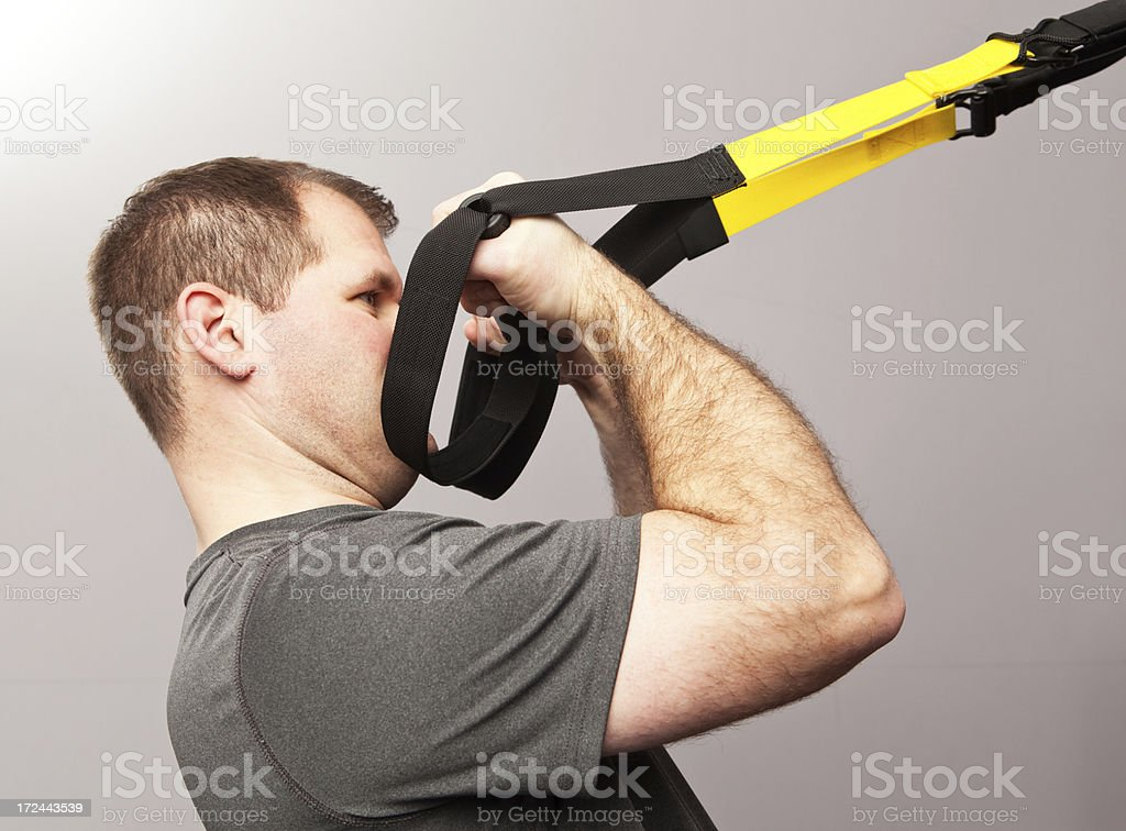 Bodyweight Bicep Curl with Suspension Training Handles royalty-free stock photo