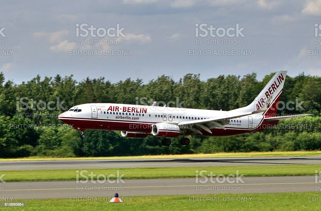 Boeing 737 800 AIR BERLIN is landing at Paderborn Airport stock photo