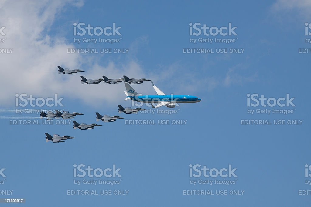 Boeing 737 escorted by 10 fighter jets royalty-free stock photo