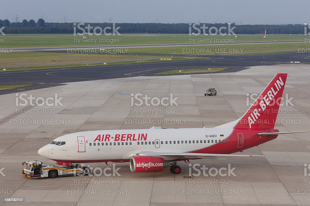 Boeing 737 of Air Berlin being towed royalty-free stock photo