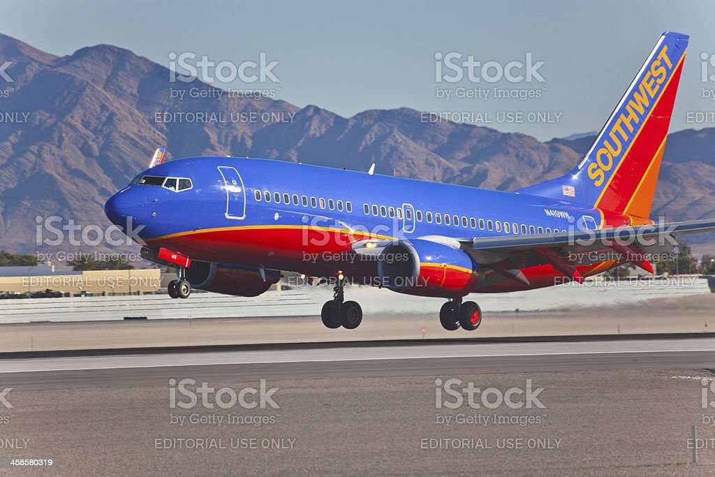 Boeing 737 Southwest lands on McCarran in Las Vegas, NV stock photo