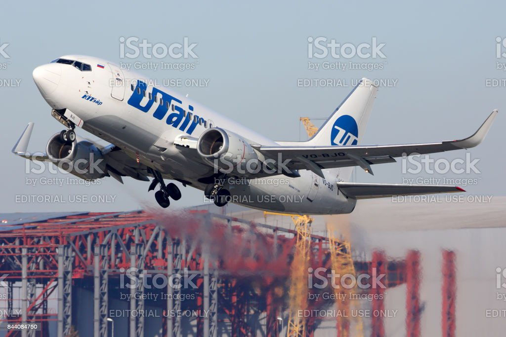 Boeing 737-500 VQ-BJO of Utair airlines taking off at Vnukovo international airport. stock photo
