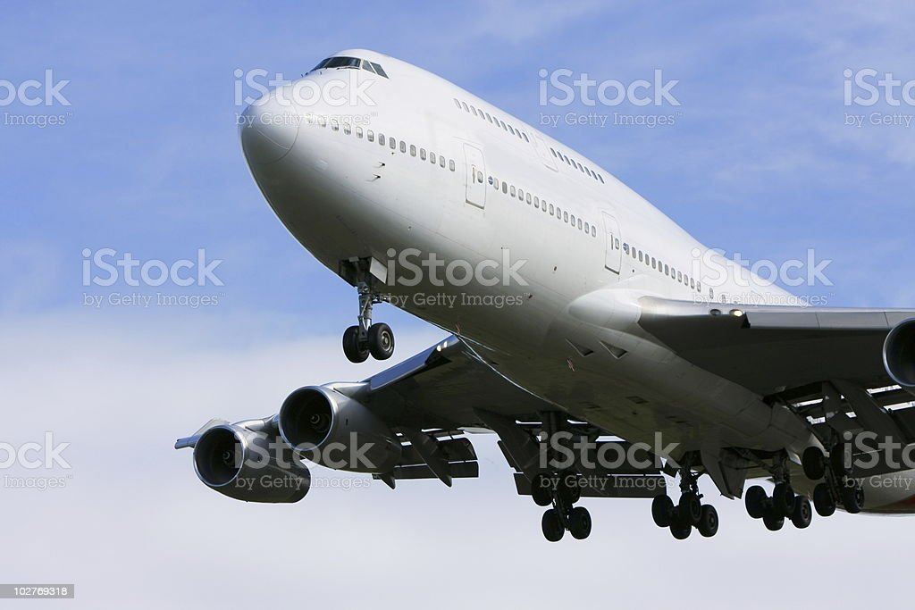 Boeing 747 airliner flying low overhead stock photo