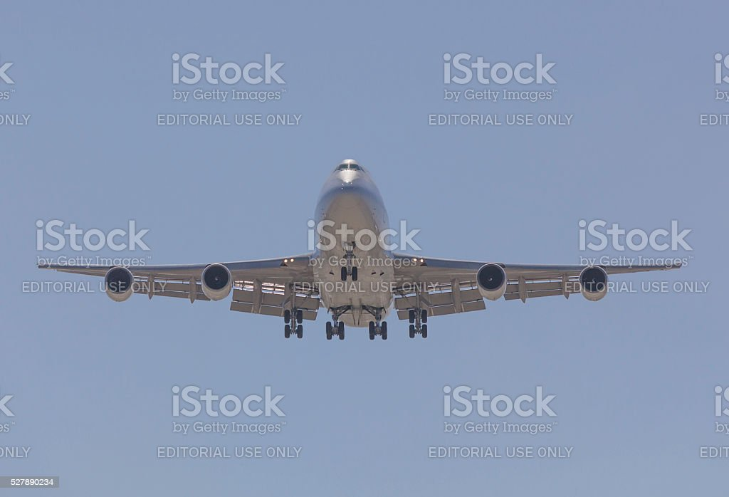 Boeing 747  airplane landing stock photo