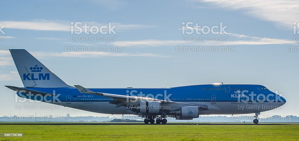 Boeing 747 of KLM landing at Schiphol Airport stock photo