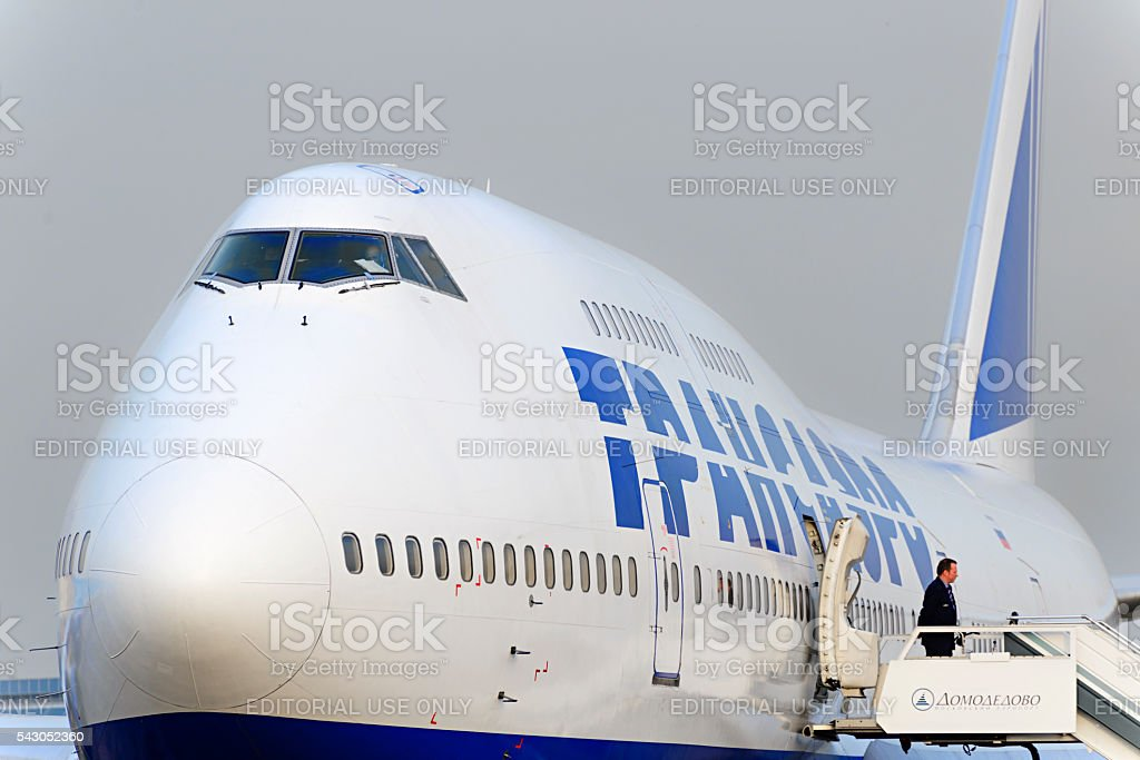 Boeing 747 Transaero waiting for boarding. stock photo