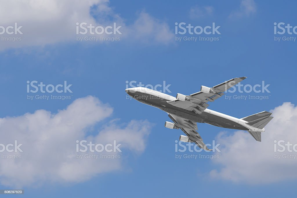 Boeing 747-400 airplane againt blue sky stock photo